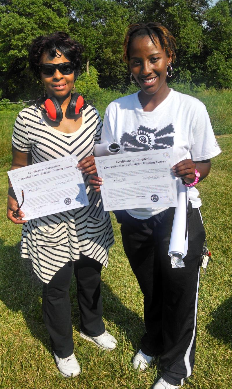 Linda & Sosha received their Certificates after shooting at the range. Good job